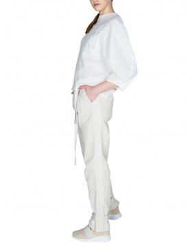 Pantaloni cu pliuri și inserție perforată